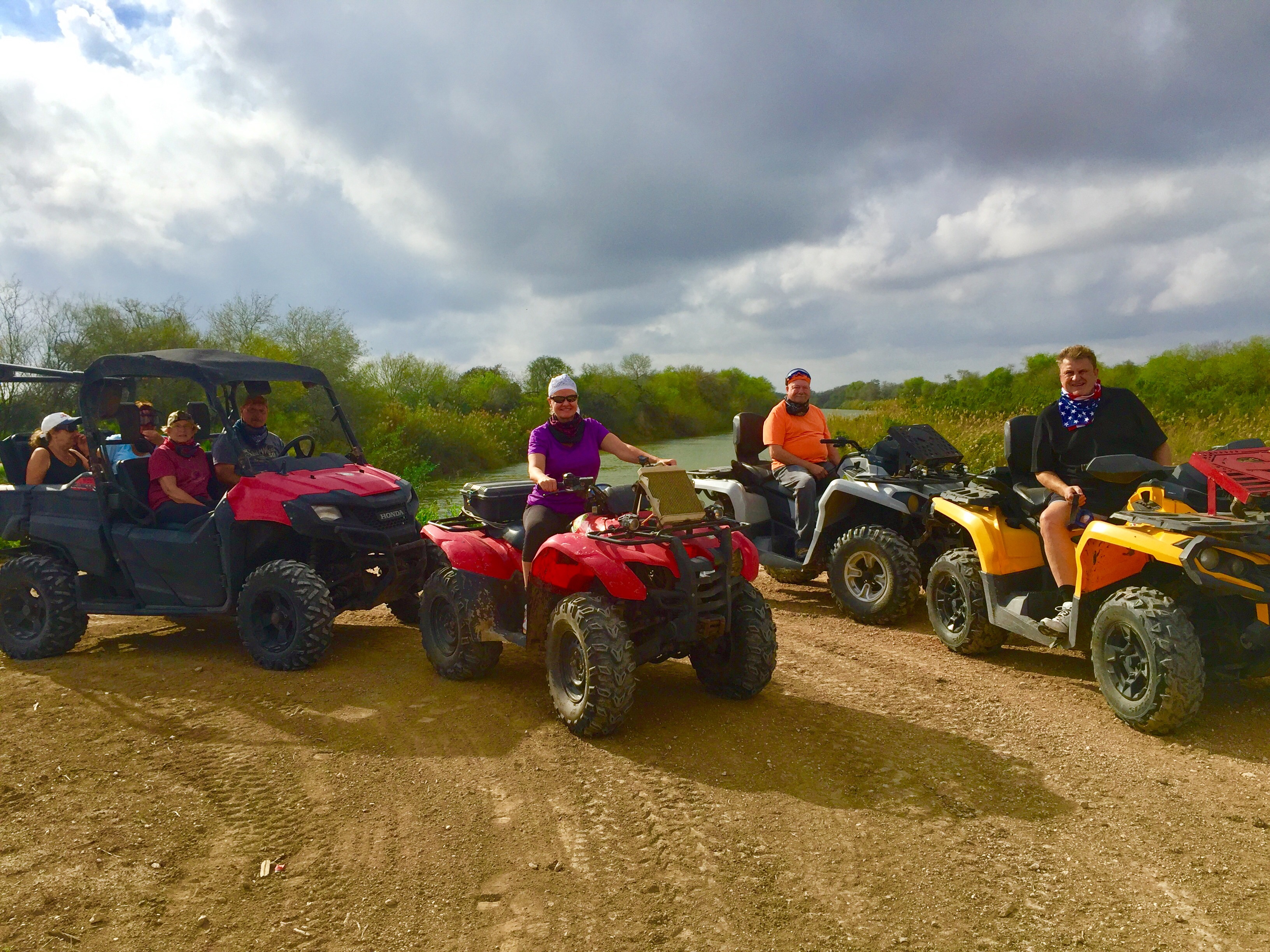 A group of winter Texans are riding Atvs by the Rio Grande River