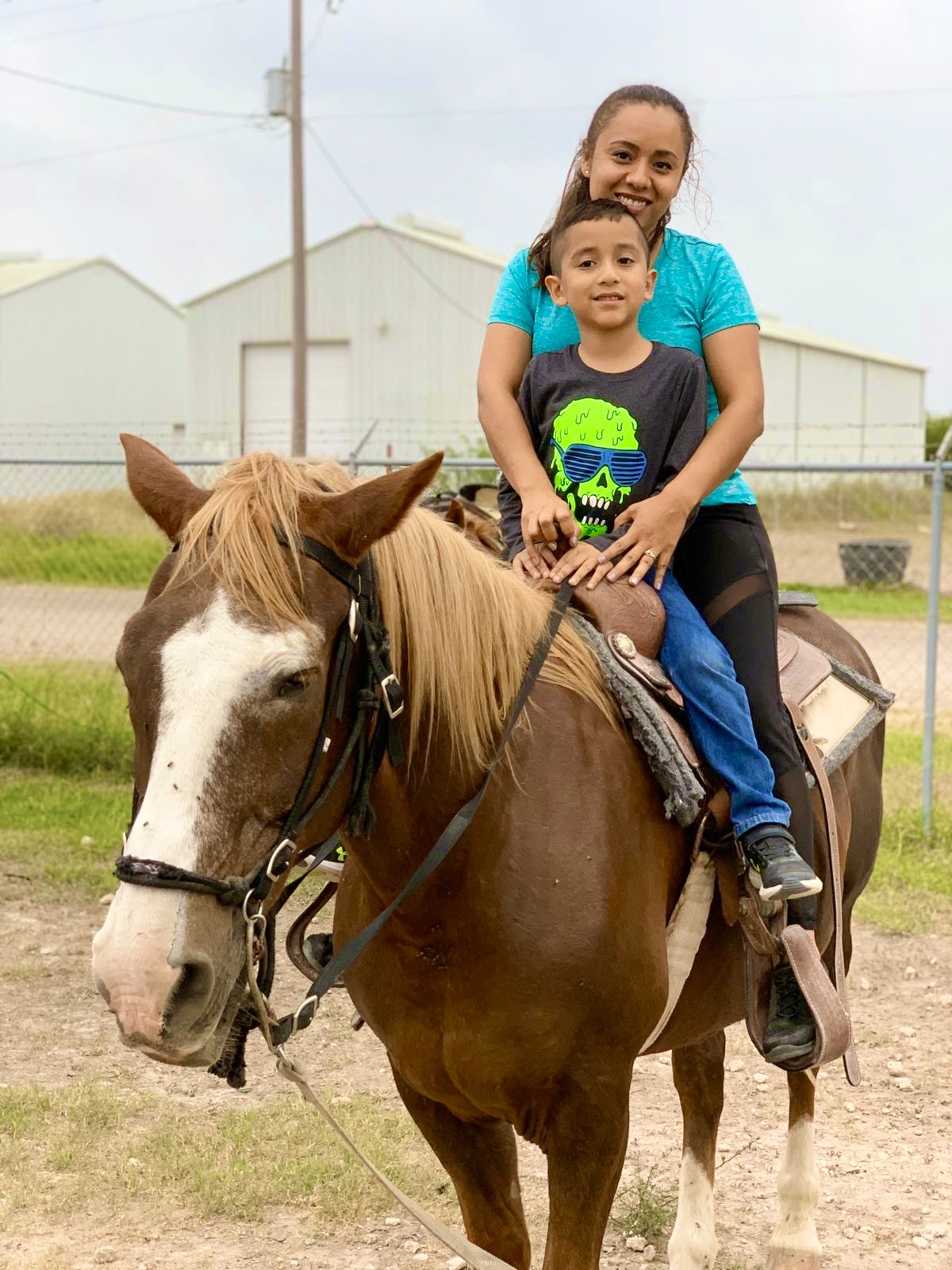 Mom and Son on a Horse